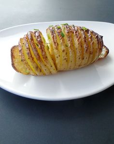 Baked Hasselback Potatoes: Crisp on the outside, tender on the inside, seasoned with Parmesan, garlic, olive oil & smoked paprika with a sprinkle of chopped chives. Named after the Stockholm restaurant Hasselbacken where it was first served.