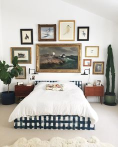 Love the gallery wall above the bed