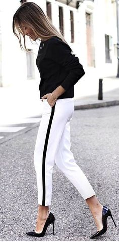 #spring #outfits woman wearing black and white pants. Pic by @vogue__cafe