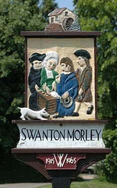 Swanton Morley - sign provided by the WI in 1965 to celebrate that year's Golden Jubilee of WIs in England and Wales.