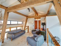 A new self build modern wood frame house, built using sustainable materials and features state of the art eco technology. More on modern wood frame houses. Timber Frame Homes, Timber House, Timber Frames, Living Room Upstairs, Wood Frame House, Oak Framed Extensions, Oak Framed Buildings, Self Build Houses, Cosy Room