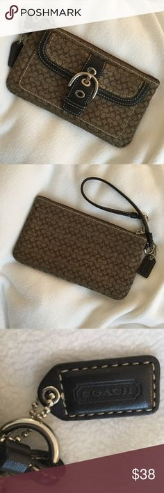 Authentic Coach Wrislet/Wallet Hard to find Coach wristlet in super condition. Zip closure.  Fully lined.  Front pocket with magnetic closure. Brass hardware.  Contrasting stitching. All over Coach logo pattern. Use as a wallet inside your purse or on its own. Logo tag included. Coach Accessories