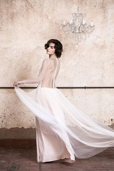 Collection includes extravagantly thorough backless bridal gowns, sensitive creations with brief, sheer sleeves and a brief, fluffy tulle gown.