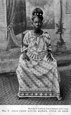 "Africa | ""Gold Coast Native Woman, Style of Hair"".  Post stamped 1909.  