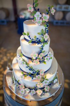 Four-tiered fondant-frosted cake {Kiel Rucker Photography}