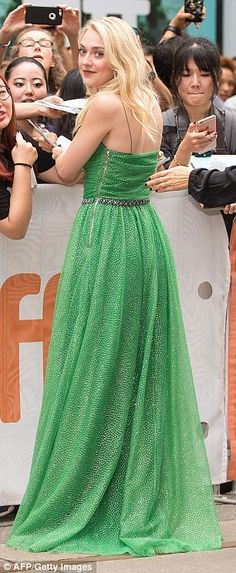 Shine bright: For the premiere, the young actress wore a glistening green…
