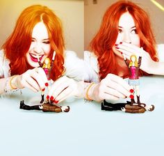 Karen Gillan who plays Amy Pond on Doctor Who.  Karen's playing with the Doctor and Amy Pond action figures... redheads