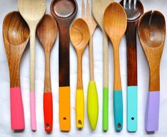 Here's a great solution for a mismatched set of wooden spoons: Sand them down and stain and dip-dye them for a bright splash of vibrant color. Once they're dry, cover them with food-safe shellac and they're ready for stirring. Click through for instructions and other easy, one-house kitchen DIY projects.