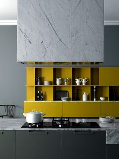 KITCHEN // Studiopepe—Meson's  yellow kitchen cabinets