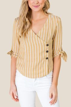 The Vivien Asymmetrical Striped Button Down features a mustard top with white stripes, buttons, and a tie at sleeves. Simple Kurti Designs, Kurta Designs Women, Short Sleeve Collared Shirts, Dress Outfits, Fashion Outfits, Dresses, Dressy Tops, Blouses For Women, Clothes