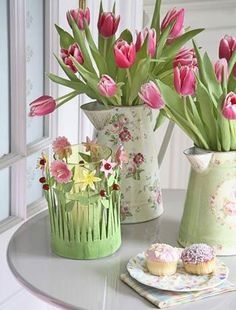 Tulip vases  Celebrate spring with colourful tulips in decorative jugs.