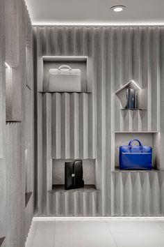 David Adjaye uses crinkled concrete panels for Valextra concession at Harrods Retail Interior Design, Retail Store Design, Retail Shop, Harrods, Store Concept, Concrete Wall Panels, Concrete Interiors, Pop Up, Concrete Design