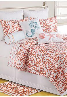 C&F Island Reef Quilt Collection ~ Stylized overlapping coral reefs come together in this overall print. The coastal inspired comforter reverses to a smaller shell and starfish print in the same colorway. Add decorative pillows to complete this aquatic themed look.