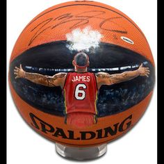 Since taking the NBA by storm in 2003, LeBron James quickly reached the top of the elite players in the league. Besides being known for his all-around game, fans have become accustomed to LeBron James' signature pregame powder toss at half court. Artist Jolene Jessie was commissioned to hand paint James in his alternate red Miami uniform on an official NBA basketball doing his signature powder toss. This extremely limited (6) LeBron James signed basketball is guaranteed authentic by ...