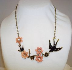 """One of Etsy's carefully sheltered resellers pretends this new necklace from China is """"vintage"""".  Buy it on Ebay or Amazon, or direct from the manufacturer:  http://www.dhgate.com/store/product/fashion-antiqued-bronze-bird-swallow-flower/142026363.html"""