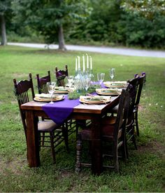 Love this setting. I love purple and gold and quaint vintage touches-ie, the candles in the bottles~
