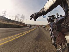 Motorcycle wave.  Shot with GoPro Hero 3 Black.  Photo by Jason Moore.
