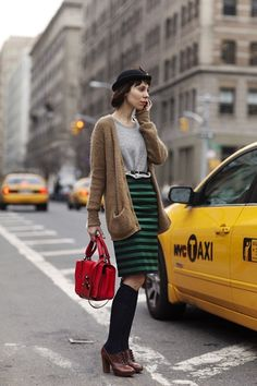 Pencil skirt, oversized cardigan, knee highs with oxfords, chic and unique.