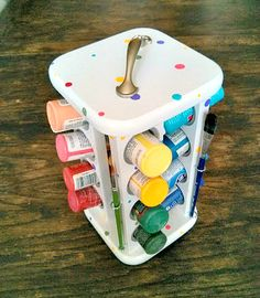 Another cute tabletop option is this fun spice rack paint caddy upcycled ~by The Palette Muse. This would be a great option if you have a smaller collection of paint & a dedicated spot for painting.