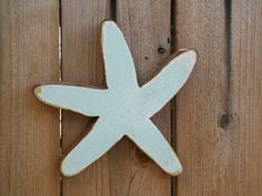 Wooden Folk Art Starfish Made From Repurposed Lumber from Hawaiian Cottages. $15.00, via Etsy.