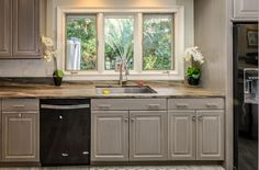 The trio of windows help keep this kitchen full of the natural South Carolina lowcountry sunlight! The large stainless steel sink makes clean-up easy - as long as the outside view doesn't call too loudly!