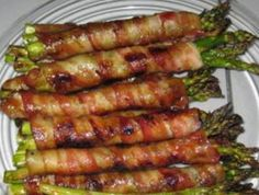 Bacon Wrapped Asparagus  Wrap asparagus in bundles of 3-4 with one slice bacon.  Melt stick of butter, 1/2 C brown sugar, 1 Tbsp soy sauce, 1/4 tsp pepper & 1/2 tsp garlic powder until boils.  Drizzle over bundles and bake at 400 until bacon is done.  Works on the grill too!