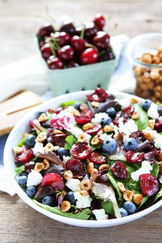 Balsamic Grilled Cherry, Blueberry, Goat Cheese, and Candied Hazelnut Salad Recipe on twopeasandtheirpod.com The perfect summer salad!