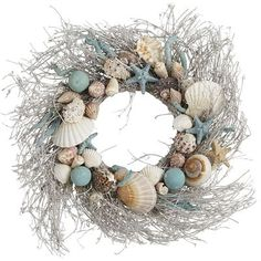 Wonderful coastal textures of dried grasses and collected seashells are brought together in unexpected colors to form this full-sized wreath. What a cool way to welcome the warmer seasons ahead.