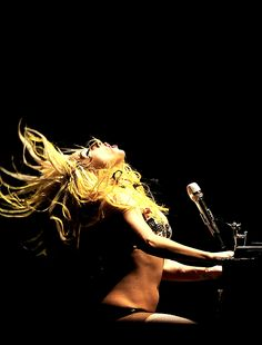 Lady Gaga at the Piano: Madison Square Garden 2011 - She can even play it a little too ;-) ... Nice Image