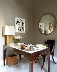Kapito Muller incorporated variations of the same color to maximize the size of this diminutive office. The tailored space includes a leather-topped mahogany writing desk with a chair from Lee Calicchio, and an Aerin mirror and artwork from Gerald Bland on the walls.