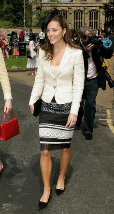 June 2005: Kate attends the wedding of a friend, wearing a lace-patterned black and white skirt with a complimentary jacket and fascinator.  Photo: Mark Cuthbert/UK Press via Getty Images