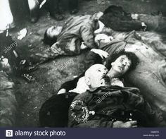 Download this stock image: BENITO MUSSOLINI (1883-1945) Italian Facist leader after execution in Milan 28 April 1945 lying on top of Clara Petacci - C8A5TD from Alamy's library of millions of high resolution stock photos, illustrations and vectors.