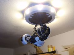 3D printable GlaDOS Robotic ceiling arm lamp