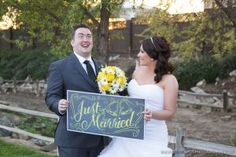 Fun couple holding just married sign