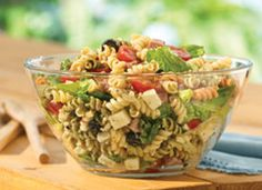 1  box Betty Crocker® Suddenly Salad® Caesar pasta salad mix  1/2  cup Italian dressing  4  cups torn romaine lettuce  1  cup cubed salami  1  cup cherry tomatoes, halved  4  oz mozzarella or provolone cheese, cut into 1/2-inch cubes (1 cup)  1  can (2 1/4 oz) sliced ripe olives, drained