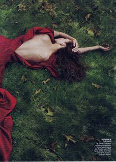 red dress with low back on grass dark romantic and goth - vogue | @andwhatelse