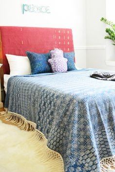 This hand-stitched patchwork quilt from India is specially made from cotton saris! It comes in Full/Queen size featuring fringe and beautiful patterns in a light indigo color. Place this quilt on a bed or couch in your home to create a cozy, boho atmosphere.