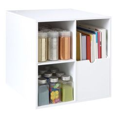 "The Recollections™ Cube with Magazine holder is designed to organize inspiration at your fingertips! The magazine holder fits 12"" x 12"" paper, oversize magazines and books vertically so you can read the spines and also has two cubbies for additional storage. The cube is sized 14 1/4"" x 14 1/2"" x 14 1/4"""