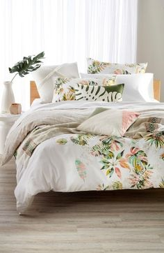 Painterly foliage adds dreamy tropical color to this hand-screenprinted duvet cover cut from crisp cotton percale.