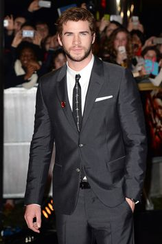 Liam Hemsworth wearing Alexander McQueen at The Hunger Games: Catching Fire premiere in London