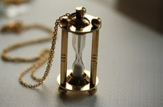 The Vintage Style Hourglass Glass Necklace*like sands in the hour glass, so are the days of our lives... *