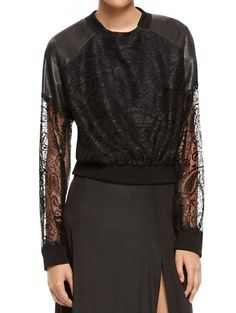 In The Black The Pull: DKNY black knit sweater with leather inserts with coated lace overlay