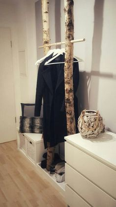 Cute birch wood clothes rack idea! Put this in your retail window for colder months