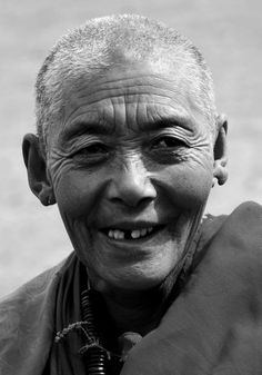 Old tibetan woman - notice it says she's a woman...