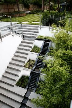 Radlett Garden Design | STUDIO CONCEPT Landscape Architects and Urban Designers    A large retaining wall within the landscape serves to open up a basement area and let light in.