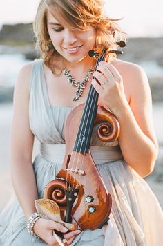 Taylor Davis--this is the dress she wears in her titanic violin video.