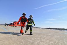 https://flic.kr/p/k46W3K | 140211-Z-NI803-145 | Raymond Cifelli, a civilian fire protection specialist from the New Jersey Air National Guard's 177th Fighter Wing, assists a U.S. Coast Guard aviator during an air mishap exercise at Coast Guard Air Station Atlantic City on Feb. 11, 2014.  The exercise,  which is an annual requirement for Air Station Atlantic City, involved the Coast Guard, Federal Aviation Administration, South Jersey Transportation Authority Fire Department, and 177th…