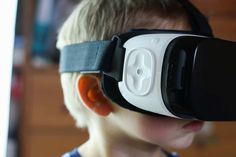 Boy wearing VR goggles