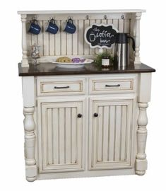 Amish Farmhouse Coffee Bar Charming and cozy for morning coffee! Hang up your favorite mugs and store plenty in the cabinets below. Amish made in solid wood. #coffeebar