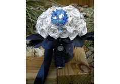 Ivory Brooch Bouquet with Navy Blue Feathers - TheWeddingMile.com